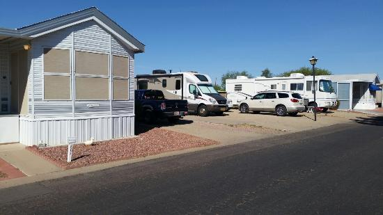 Sun City, AZ: This is not an RV Resort!  It is a single wide manufactured home park!  Our space is dirt with a