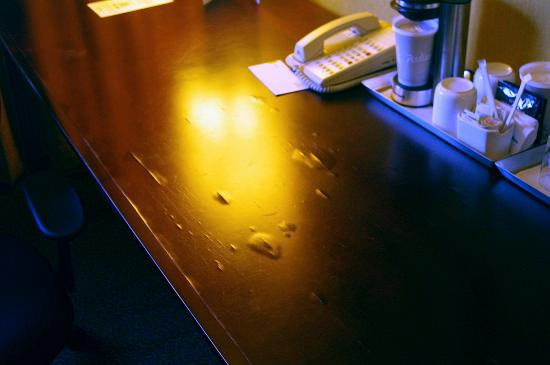 Radisson Nashua Hotel: Bubbled and delaminated surface of the work desk.
