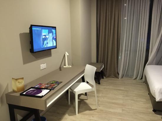 tv and work desk picture of qliq damansara petaling jaya