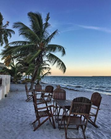 Velisa's : Tables on the beach