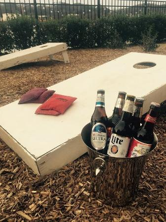 Waterside Lounge: Enjoy Corn Hole On Our Riverfront Patio!