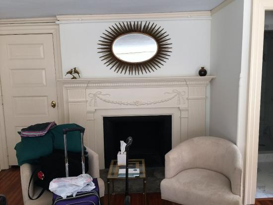 Fireplace and charis in the room - Picture of Anchorage 1770 Inn ...