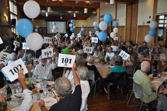 Northwest Maritime Center : A packed house (144ppl) raise their bid cards for the NWSWB at the NWMC
