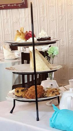 Chat Noir: Tea time elegance - a 3 tier serving of yumminess served with your tea of choice!