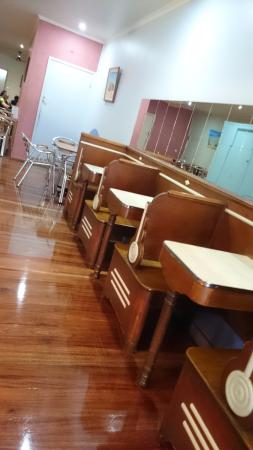 Super Star Cafe: A row of old school diner booths; more (modern) seating at rear.