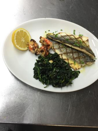 Simple seabass - spinach with garlic and fresh lemon with jumbo US king prawns