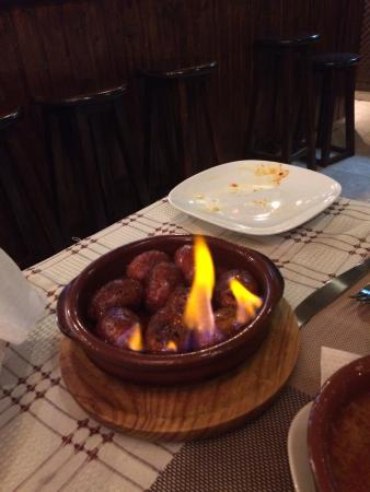 El Rincon Canario: Flaming Chorizo, tasted so good! Ideal for two to share.