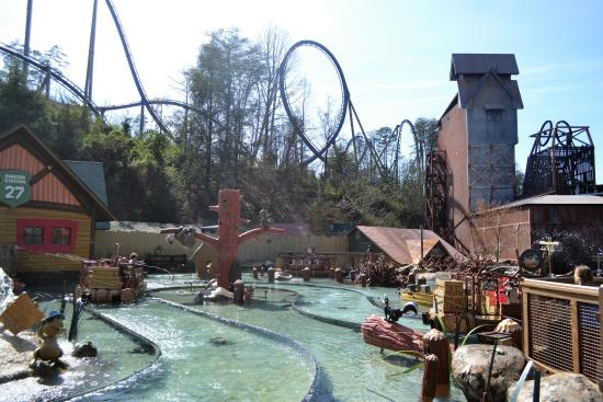 River battle w/ roller coaster behind it - Picture of