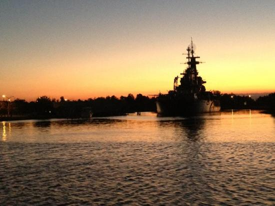 Wilmington Water Tours: awesome sunset with USS NC Battleship in background