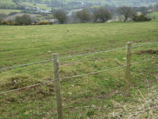 Offa's Dyke Path National Trail: Overlooking Rhuallt with remnants of the Dyke beyond the barbed wire.