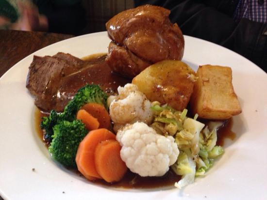 Queen Camel, UK: Delicious roast, friendly and efficient service with a warm log fire. Prices were reasonable too