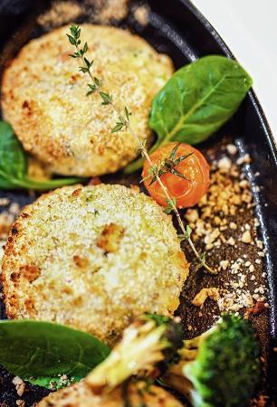 Shtastlivetsa Vitoshka: ROASTED BROCCOLI BALLS WITH PHILADELPHIA mousse and cheese on a plate LAVA, served with MILK SAU