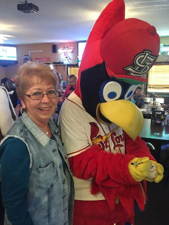 Maryville, IL: Fredbird signing a baseball for Jeri at Boogies