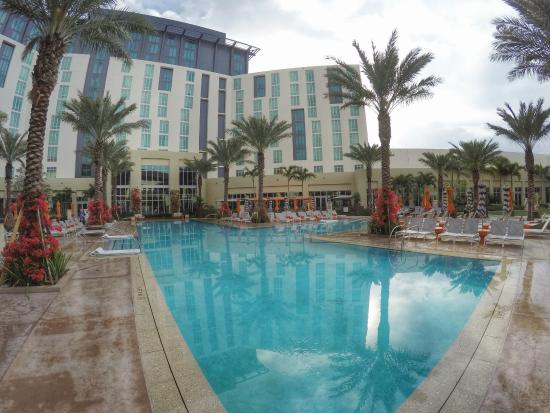 The swimming pool makes you feel like you are far away from the city picture of hilton west - Palm beach swimming pool ...