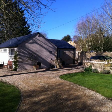 Clanfield, UK: Hunter's Cottage in March sunshine.