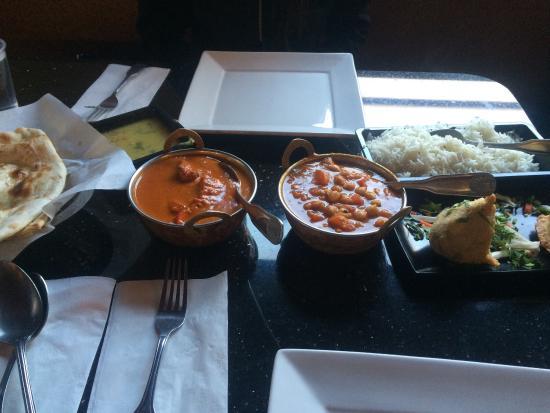 Goleta, CA: Chicken tikka masala with naan, Chana masala with rice and lentils, vegetable samosas, and mango