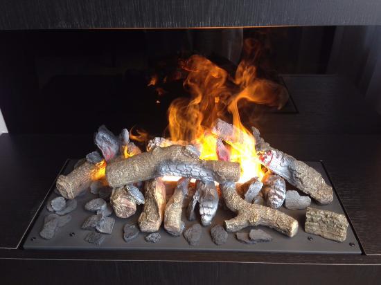 fake but looks like a gas log fireplace very nice at night rh tripadvisor co uk