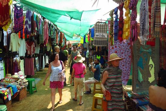 Anjuna, India: Clothes section of the market in makeshift tents