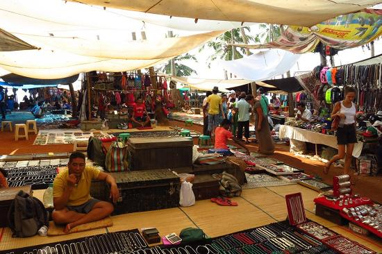 Anjuna, India: The international section of the market where you will find foreign merchants