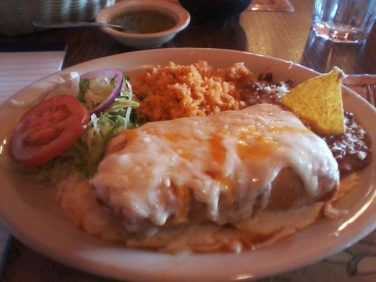 Melrose, MN: My chimichanga smothered with cheese, served with refried beans, Spanish rice, and lettuce.