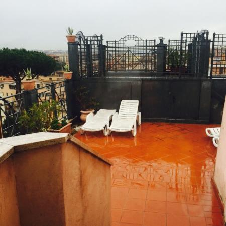 Sunrise Hotel: Roof terrace on a wet day