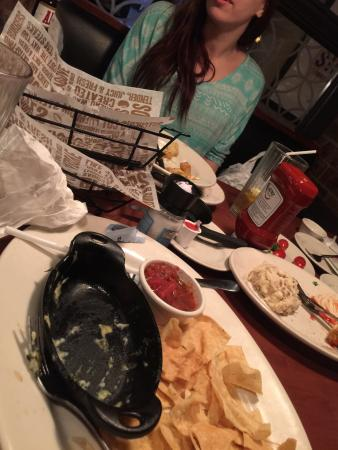 O'Charley's: Dishes not cleared during entire meal. All piled up. Awful service