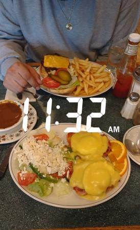 Canadiana Restaurant: My meal: Eggs Benedict with a side Greek salad, His: Charbroiled burger with fries and gravy