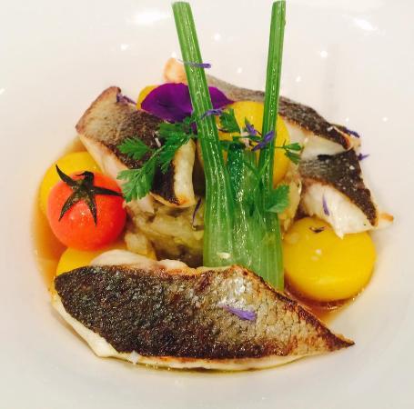 """Cafe des Banques: Seabass """"goujonnettes a la plancha"""", rock broth, fennel compote and saffron charlotte potatoes"""