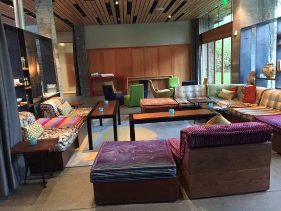 H2 Hotel: Comfy sitting area-Meeting rooms behind wooded panels