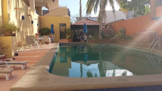 Las Gaviotas Resort: pool area with breakfast tables far left