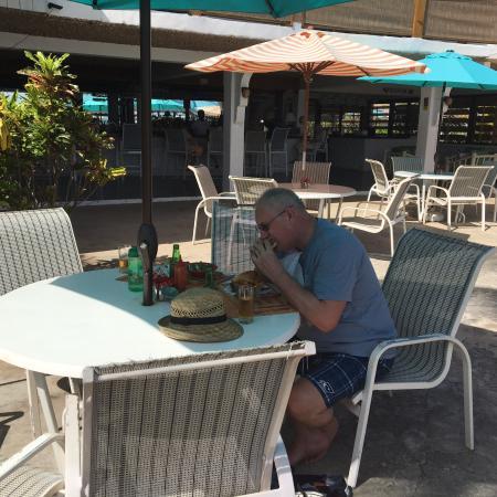 Anchorage Yacht Club Restaurant: George enjoying his burger