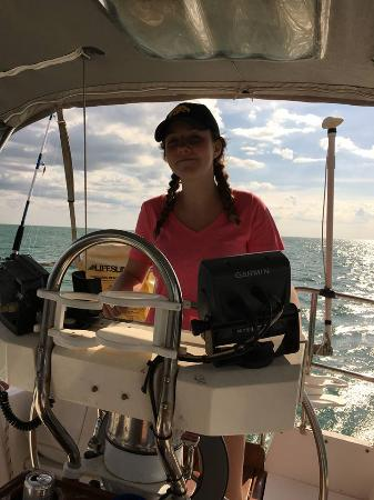 Harvest Moon Charters: Olivia sailing us back to harbor listening to the Beach Boys - it was a GREAT afternoon!