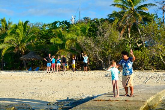 Navini Island, Fiji: Our new friends waving us off as the boat took us back to the main island to catch our flight!