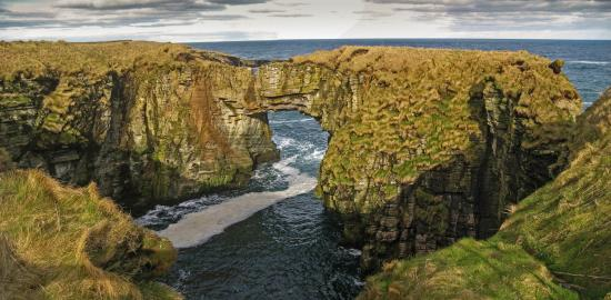 Stronsay, UK: The iconic arch on a calm day