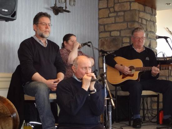 Michael, owner of Glyde Inn, Dunleer, Co. Louth, Ireland playing harmonica with local band