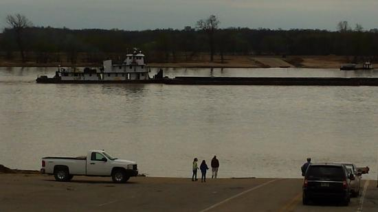 Marion, KY: View of the Ohio river from the Illinois side of the Cave-in-Rock Ferry area. Barge passing.