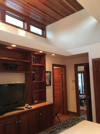 Winvian: Industry Cottage bedroom, looking toward the bathroom and living room.
