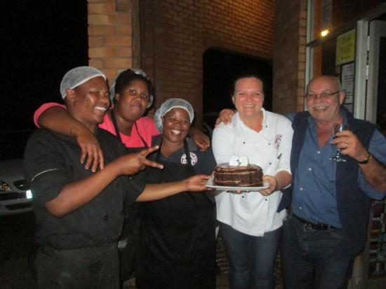 The Barefoot Cafe: Jana, chef, and staff giving Trevor his cake