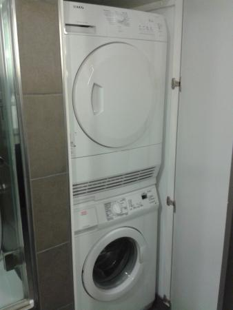 Washing Machine/Dryer in bathroom cupboard in apart 611 - washing ...