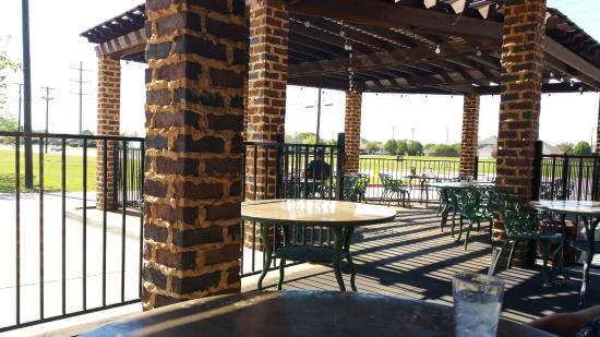 outdoor dining on the patio picture of deno s kitchen and spirits rh tripadvisor com