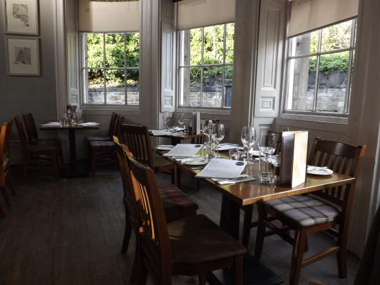 extensive dining room area with a gallery and a raised platform at rh en tripadvisor com hk