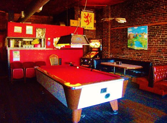pool table and pinball machine in the side room west of the bar rh tripadvisor com