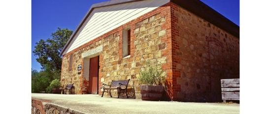 Glenrowan, Australia: The old stone cellar - views across the vineyards to the hills, from the porch