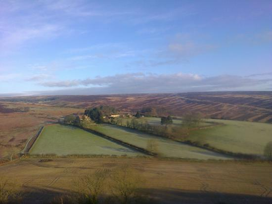 Lastingham, UK: Looking down over the house from the top of the Nab and towards Spaunton Moor and Rosedale