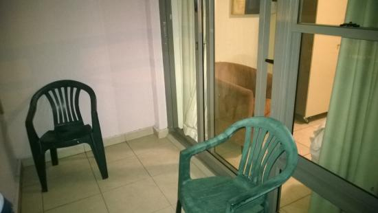two plstic chairs on the rather large balcony picture of the rh tripadvisor com