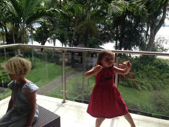 Fitzroy Island Resort: Kids enjoying some chips on the balcony. Literally a stone's through to the beach