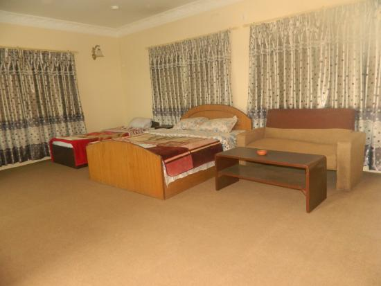 Om Tara Guest House: Deluxe family room has private kitchen,1 king-sized and 1 single bed,balcony,bathroom with bath-