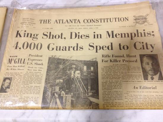 Monroe, GA: Old newspapers for sale.