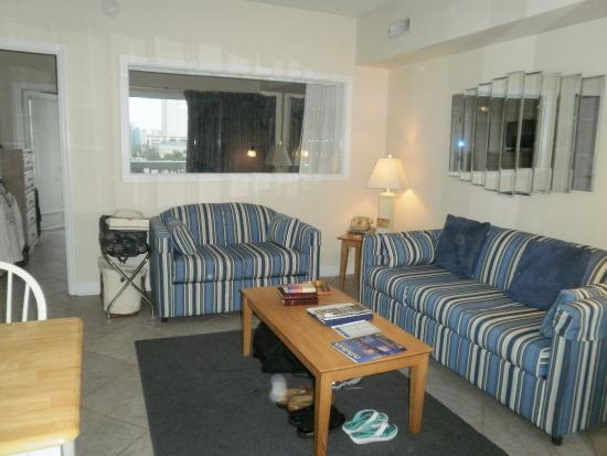 Riptide Beach Club: Living room area. Sofa opens to a bed. There are blinds to draw between the L.R and bedroom