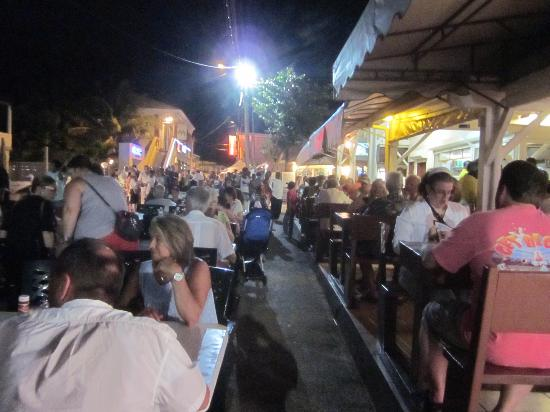 Les Mardis de Grand Case (Harmony Night): Busy Lolos with extra seating in the street for Harmony Night